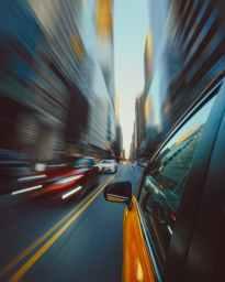 panning photo of yellow car